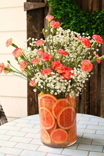 Floral arrangement using sliced oranges as packing and medium