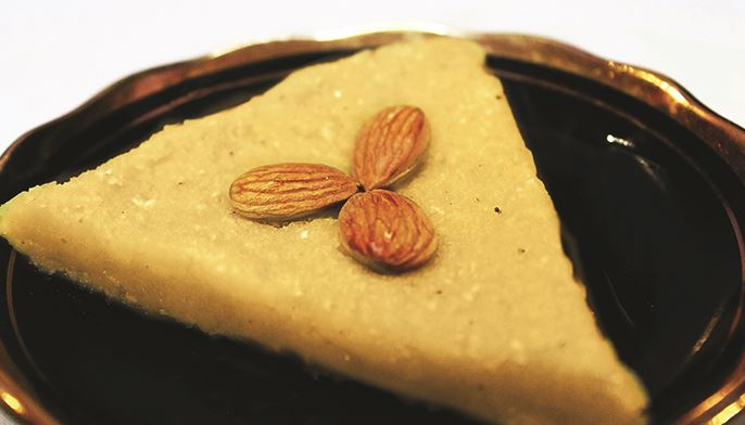 Khabeesa on a plate with almonds